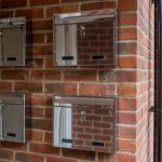 W2N Wall Mounted Stainless Steel External Post Box installed on a brick wall