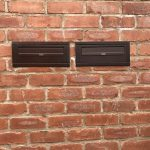 SM Copper Through The Wall External Post Box installed in a brick wall