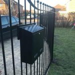 Gate Post Box Mounted on Metal Railings