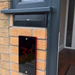 Rolle Rear Access Post Box under a porch window