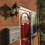 Wall Mounted Post Box White Letterbox mounted on a brick wall