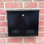 Wall Mounted Post Box Black mounted on a brick wall