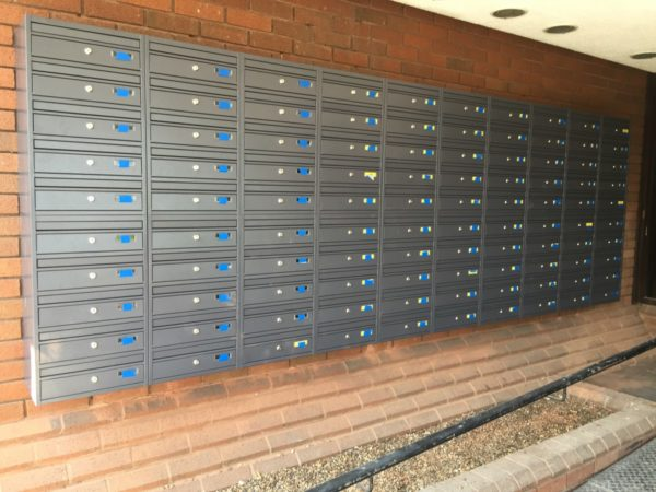 Dark grey multiple  wall mounted letterboxes